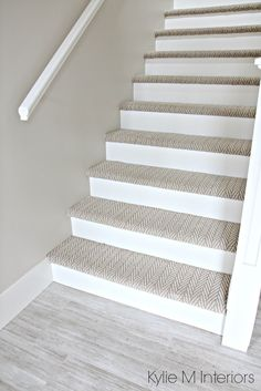 Stairs with carpet herringbone treads and painted white risers, looks like  a runner. Benjamin